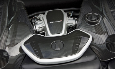 Exotic carbon fiber intake and boolant tank covers installed on a Mclaren 650s